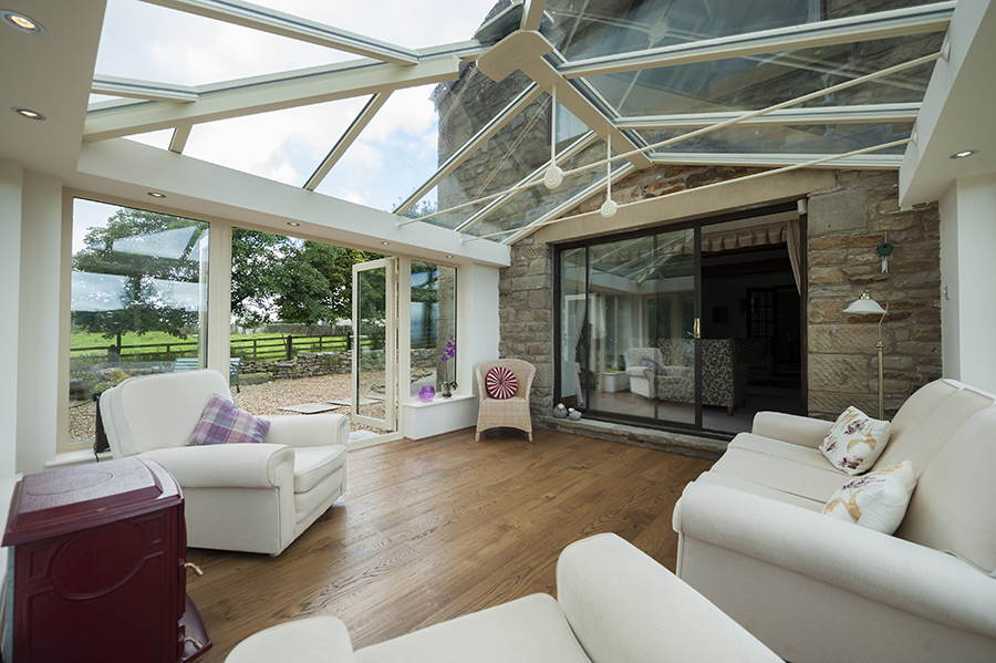 Siting room loggia conservatory looking out to garden