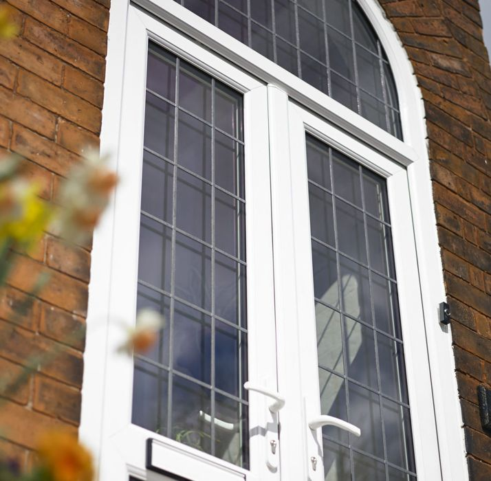 Upvc french doors for exterior internal safestyle uk for Arched upvc french doors